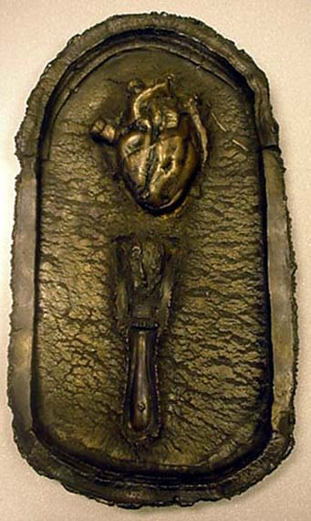 Photo of a sculpture featuring an anatomical heart.