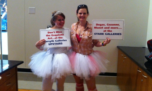 Photo of two students wearing tutus, advertising the Degas Exhibition