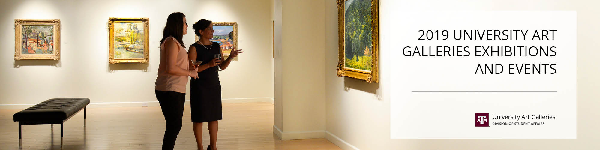 Two women viewing painting on gallery wall