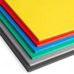 Stack of brightly colored foam core sheets.