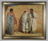 Three male Native American figures, one with his back to the viewer, facing the other, two wearing a green robe or blanket with red and white vertical stripes and holding a braided whip in his proper right hand, the other two wearing white, standing against an adobe wall.