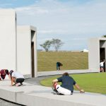 Students are seen cleaning the Bonfire Memorial