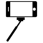 Silhouette of a phone on a selfie stick