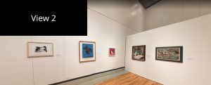 Interior view of the J. Wayne Stark Galleries in the main gallery space. In the distance you can see paintings on the walls.