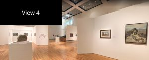 Interior view of the J. Wayne Stark Galleries in the main gallery space. In the distance you can see paintings on the walls and a sculpture in a case.