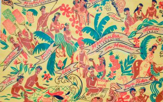 Closeup of framed print of Aloha design; Hawaiian people and palm trees on a vibrant yellow background